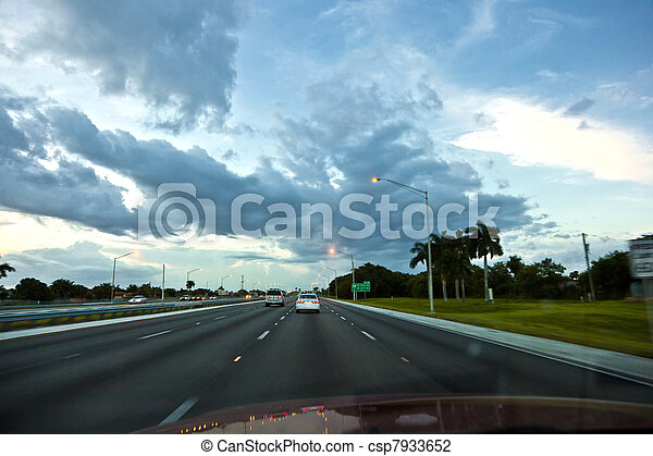 driving car in the evening on the Highway