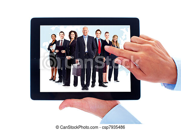 Tablet computer and group of business people. - csp7935486
