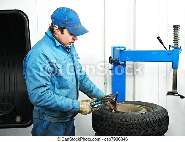 machanic repairman at tyre fitting - csp7936346