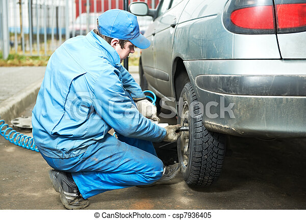 machanic repairman at tyre fitting - csp7936405