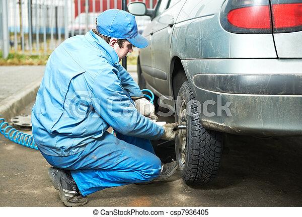 machanic repairman at tyre fitting - csp7936405