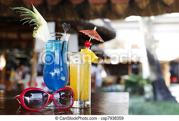 alcoholic cocktails and sunglasses in the beach cafe - csp7938359