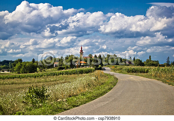 Beautiful green village scenery landscape in spring time - csp7938910