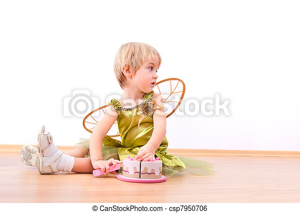 Cheerful fairy little girl cutting toy cake - csp7950706