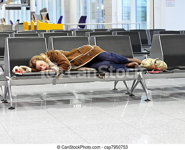 Passenger spending a night at airport after flight cancelation - csp7950753
