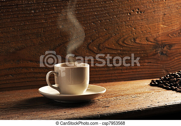cup of coffee on the wooden table - csp7953568