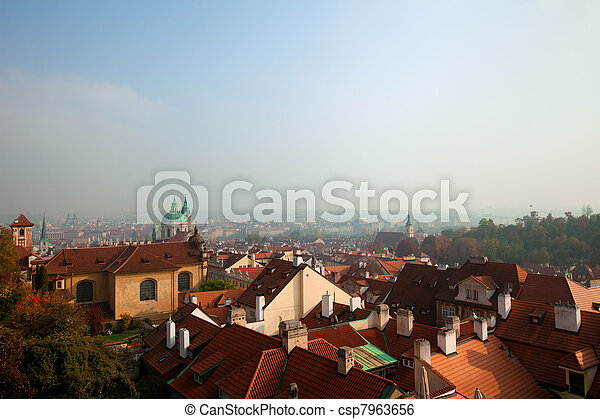 Old Prague roofs at autumn morning - csp7963656