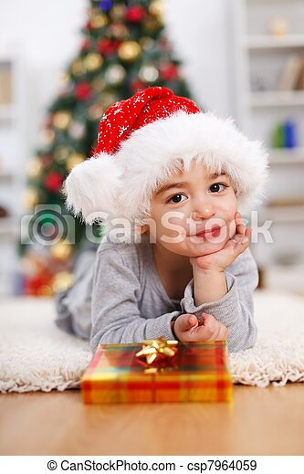 Little Christmas boy with Christmas present - csp7964059