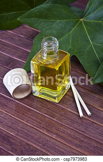 bottle of perfume oil in the environment of the spa - csp7973983