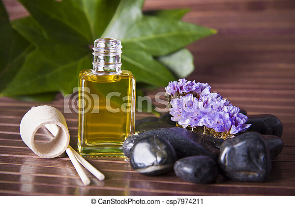 bottle of perfume oil in the environment of the spa - csp7974211