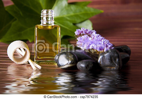 bottle of perfume oil in the environment of the spa - csp7974235