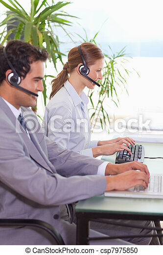 Hotline employees at work - csp7975850