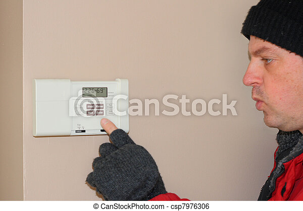 home thermostat showing importance of furnace maintenance to avoid breakdown - csp7976306