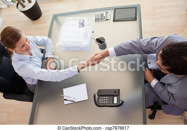 Above view of consultant shaking hands with customer - csp7976617