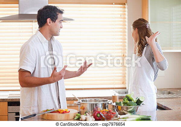 Couple has a tensed situation in the kitchen - csp7976654