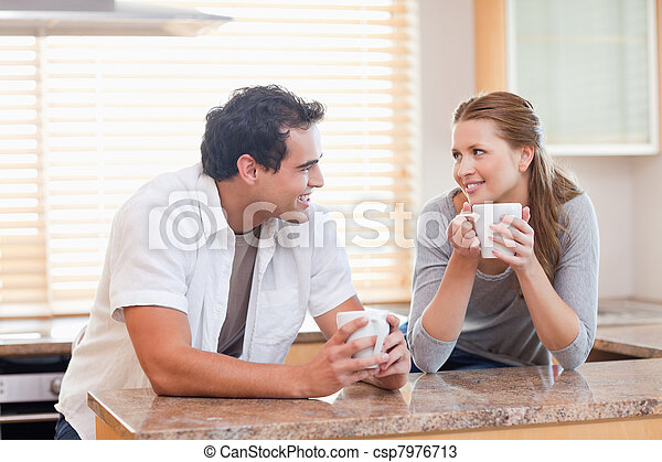 Couple enjoying coffee in the kitchen together - csp7976713