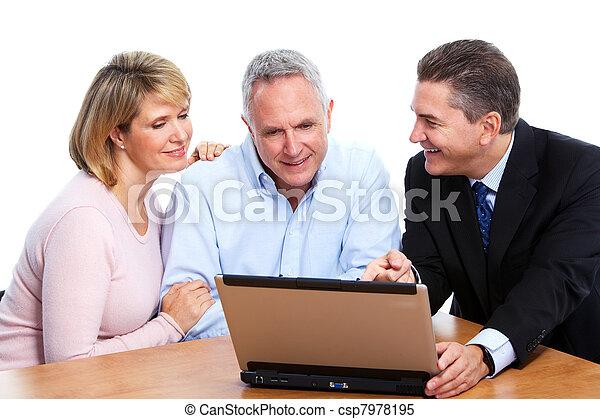 Senior couple with financial adviser. - csp7978195