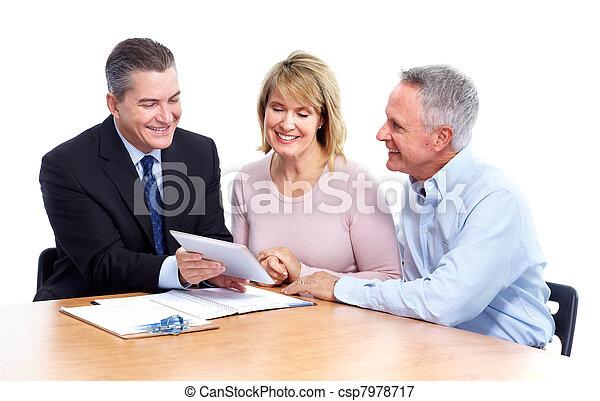 Senior couple with financial adviser. - csp7978717