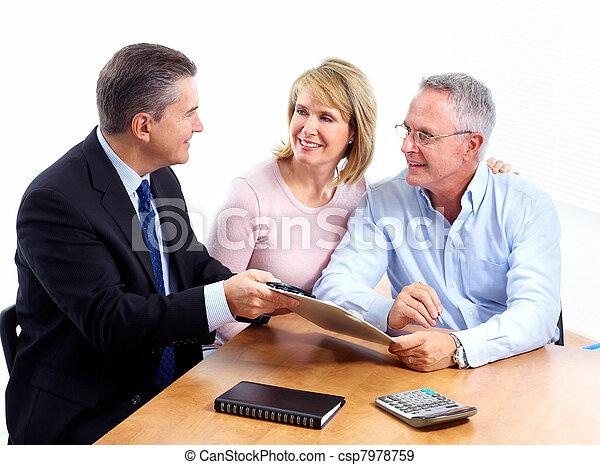 Senior couple with financial adviser. - csp7978759