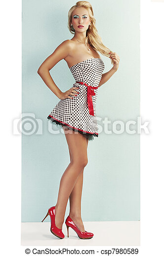 sensual pin up with red shoes - csp7980589