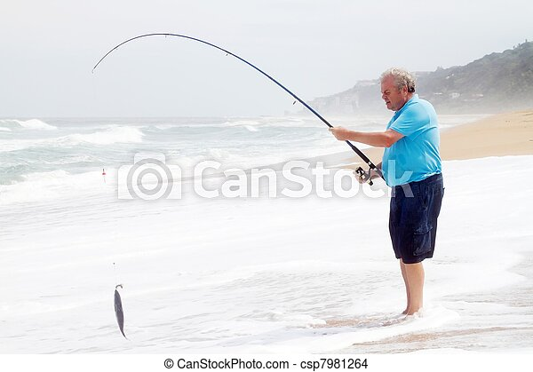 Stock photo of senior man catching a fish with fishing rod for Senior fishing license