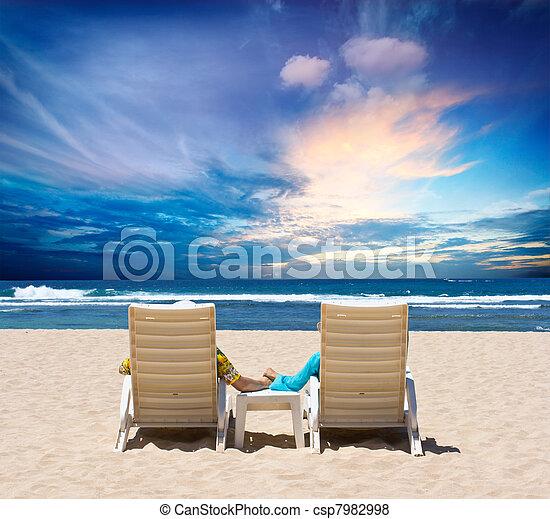 Honeymoon couple enjoy ocean sunset - csp7982998