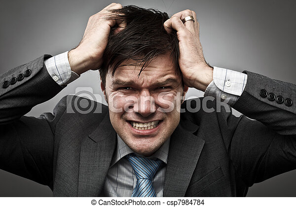 Businessman pulling his hair - csp7984784