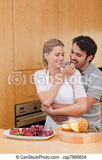 Portrait of a young couple eating fruits - csp7985654