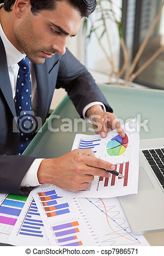 Portrait of a young sales person studying statistics - csp7986571