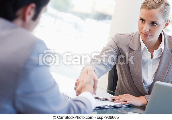 Serious manager interviewing a male applicant - csp7986605