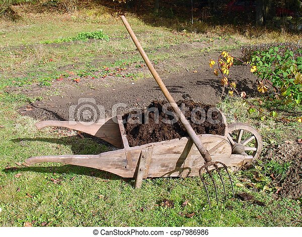 Wheelbarrow full of manure - csp7986986