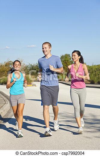 Three Interracial Young Adult Friends Running Jogging - csp7992004