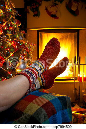 girl resting in room with fireplace Christmas - csp7994509