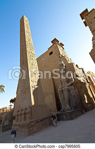 Statues of Ramses II and Obelisk in Luxor Temple - csp7995605