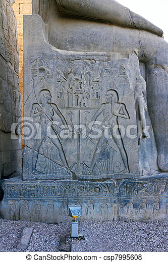 Hieroglyphics on throne of Ramses II Statue - csp7995608