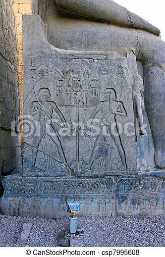 Hieroglyphics on throne of Ramses II Statue - csp7995608