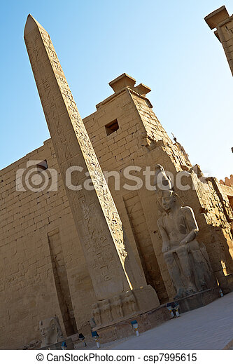 Statues of Ramses II and Obelisk in Luxor Temple - csp7995615