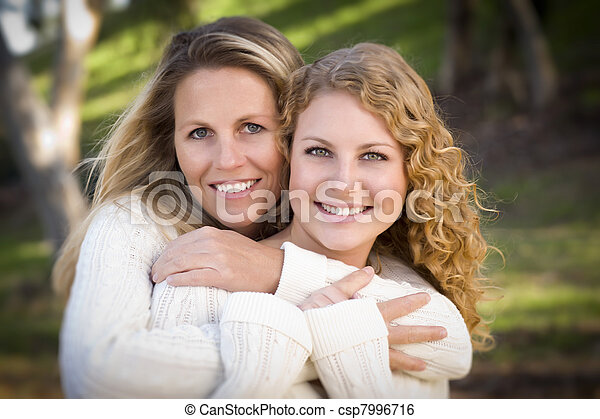 Pretty Mother and Daughter Portrait in Park - csp7996716
