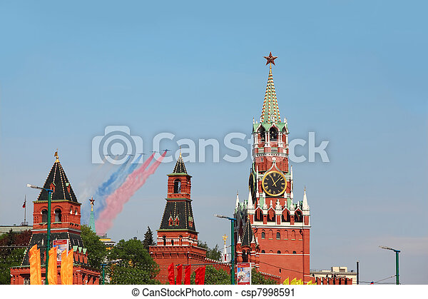 MOSCOW - MAY 9: Airplanes make color contrail of russian flag colors and fly over Red Square, Spasskaya Tower on parade in honor of Great Patriotic War victory on May 9, 2010 in Moscow, Russia - csp7998591