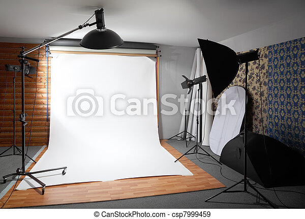 White background inside studio - dark room lighted big lamps and spotlights - csp7999459