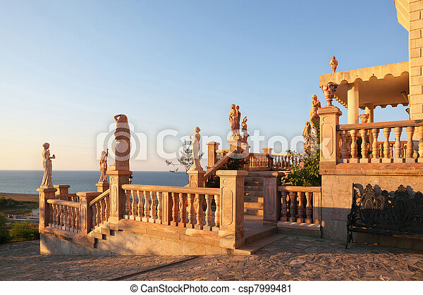 Large parade stair is decorated ancient statues and modelling, anchorwoman in  palace with  view at  seaside - csp7999481