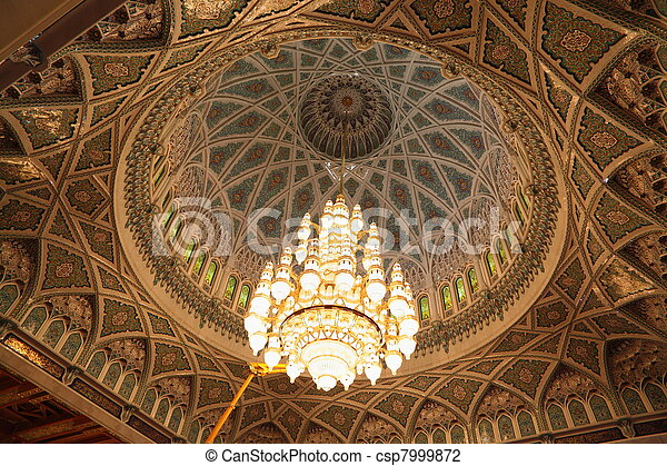big beautiful lustre in a hall of Grand Mosque in Oman. the lights is on. - csp7999872