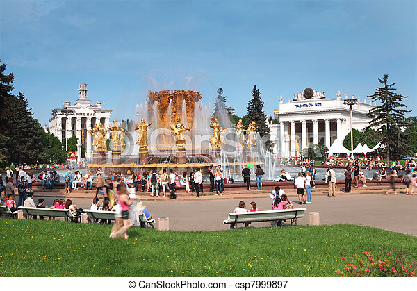 MOSCOW - MAY 15: People near fountain of nations friendship and exhibition halls at All-Russia Exhibition Center on May 15, 2010 in Moscow, Russia. The exhibition was established February 17, 1935 - csp7999897