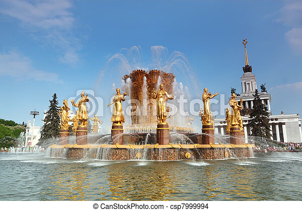 MOSCOW - MAY 15: Fountain of nations friendship and main exhibition hall at All-Russia Exhibition Center, sunny day on May 15, 2010 in Moscow, Russia. The fountain was build in 1954 - csp7999994