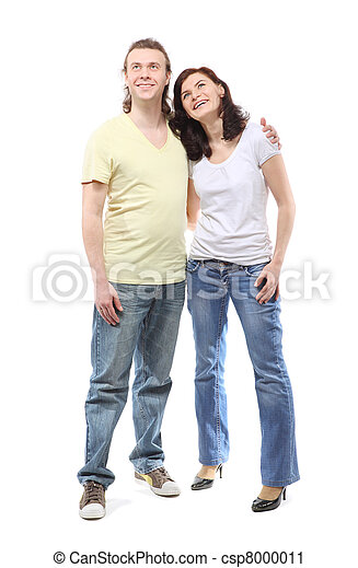 Young couple in jeans, boy and girl, are standing in embrace and looking up - csp8000011
