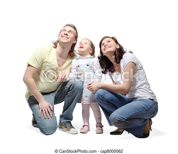 Mother, father and little daughter sit down, hold hands and fixedly looking up with smile - csp8000062