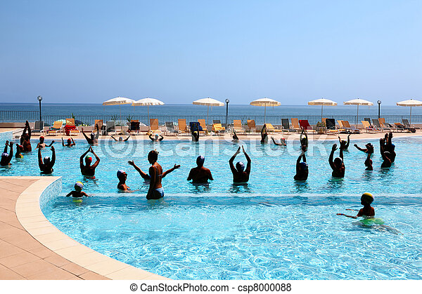 Many people in  pool are engaged in  sporting training in  day-time under open-skies - csp8000088