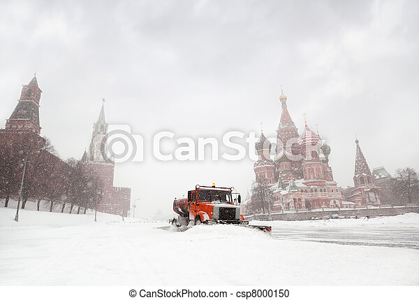 Snow-remover truck clean the road near Red Square, St Basil Temple and Spasskaya Tower of Kremlin in Moscow, Russia at wintertime during snowfall - csp8000150
