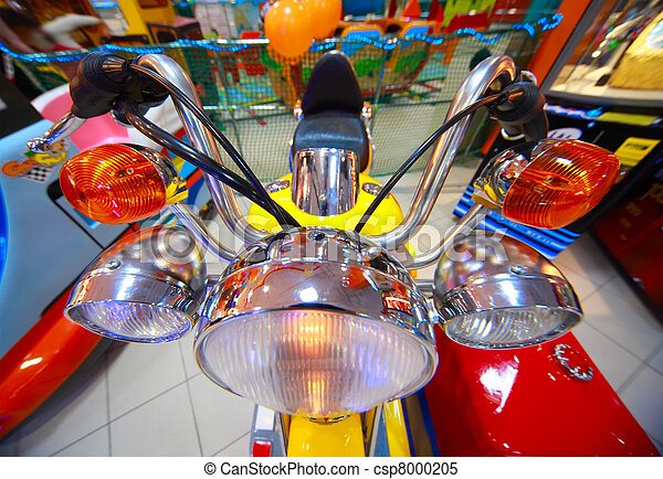 Close-up view of childish small yellow-red tricycle with headlights - csp8000205