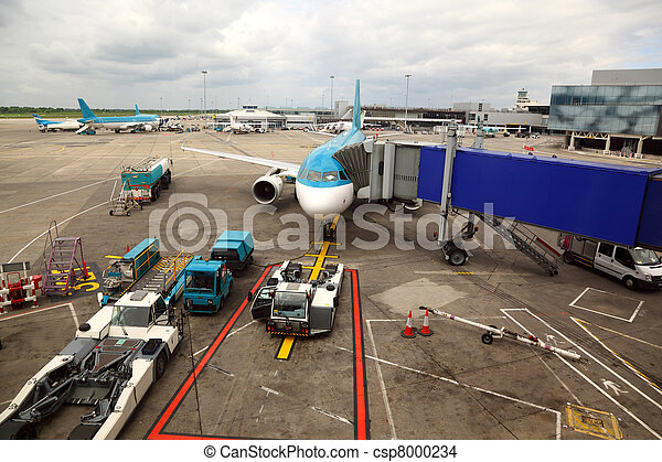 unreal airliner parked at airport. boarding passengers tube. service technician - csp8000234